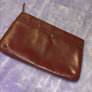 Vintage Etienne Aigner burgundy leather clutch.